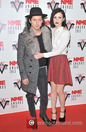 Carl Barat and Edie Langley of The Langley Sisters - The 2013 NME Awards held at The Troxy - Arrivals...