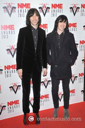 Bobby Gillespie and guest - The 2013 NME Awards held at The Troxy - Arrivals - London, United Kingdom -...