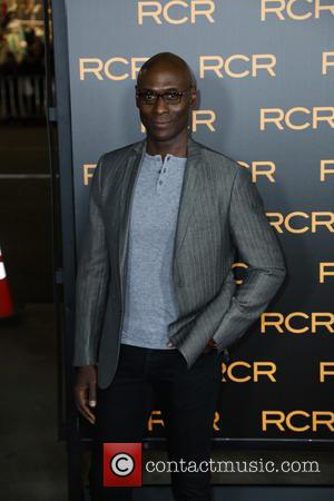 Lance Reddick - Los Angeles premiere of 'Phantom' at the Chinese Theatre - Arrivals - Los Angeles, California, United States...