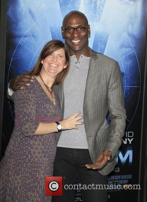 Lance Reddick and wife Stephanie - 'Phantom' Los Angeles Red Carpet Premiere at the Chinese Theater - Los Angeles, California,...