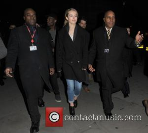 Bridgit Mendler - American actress and musician Bridgit Mendler flanked by her security outside the BBC Radio 1 studios -...