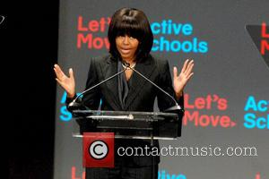 Michelle Obama - First Lady Michelle Obama unveils a new 0M 'Let's Move! Active Schools' program at the McCormick Place...