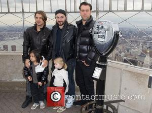 Axel Christofer Hedfors, Steve Angello and Sebastian Ingrosso - Swedish House Mafia light the Empire State Building yellow and blue,...