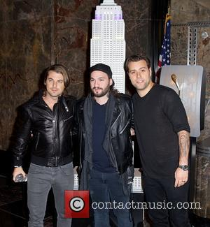 Steve Angello, Axel Christofer Hedfors and Sebastian Ingrosso - Swedish House Mafia light the Empire State Building yellow and blue,...