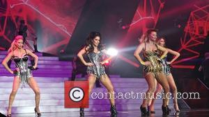 Girls Aloud, Kimberley Walsh, Nadine Coyle, Cheryl Cole and Sarah Harding - Girls Aloud performing live in concert on their...