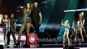 Girls Aloud, Nadine Coyle, Cheryl Cole, Sarah Harding and Nicola Roberts - Girls Aloud performing live in concert on their...