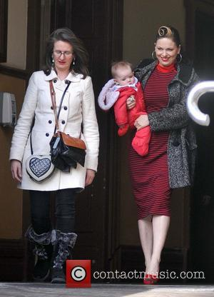 Imelda May and daughter Violet Kathleen Higham - Singer Imelda May is presented with the Gold Medal of Honorary Patronage...