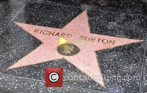Richard Burton and Elizabeth Taylor Snuggle Up Together On The Hollywood Walk of Fame