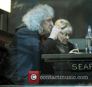 Brian May and Anita Dobson - Brian May,Anita Dobson take a having a drink at St. Pancras Station - London,...
