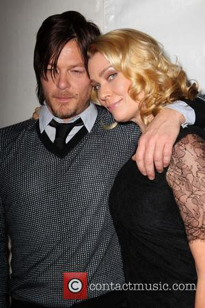 Norman Reedus and Laurie Holden