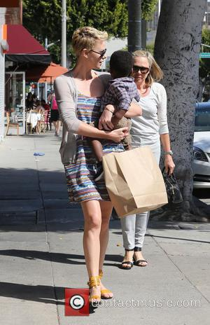 Charlize Theron and Jackson Theron - Charlize Theron leaves a children's hairdresser and makes her way back to her car...