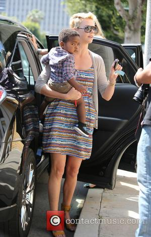Charlize Theron and Jackson Theron - Charlize Theron returns to her car after taking her son, Jackson to get his...