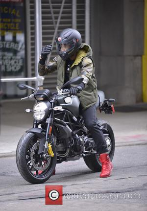 Usher Raymond - R&B star Usher Raymond takes his new Ducati motorcycle for a spin shortly after collecting it from...