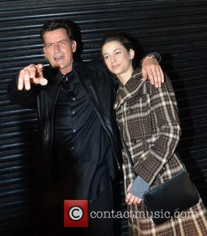 Charlie Sheen and Georgia Jones - Charlie Sheen poses for the cameras with his girlfriend, Georgia Jones before attending the...