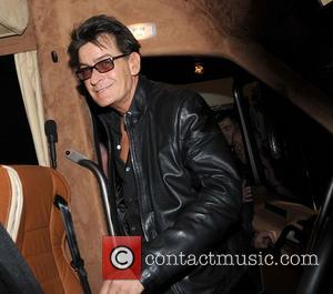 Charlie Sheen - Charlie Sheen in good spirits as he boards his bus after leaving The Olympia Theatre, where he...