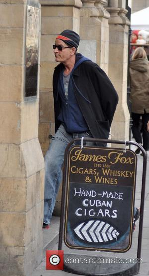 Charlie Sheen - Charlie Sheen spotted on Grafton street in Dublin. He shopped at James Fox, Cigars, Whiskey and Wines...