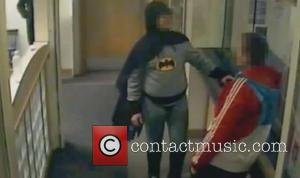 A vigilante dressed as Batman has handed a wanted person into Bradford police. The caped crusader entered Trafalgar House Police...