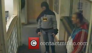 Batman - Batman hands wanted man into Bradford Police