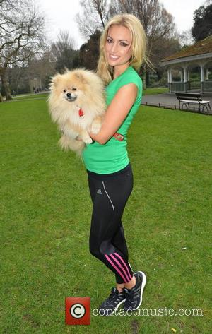 Rosanna Davison and Ted - Former Miss World and Playboy cover girl Rosanna Davison poses with her dog Ted to...