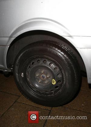Katie Price and Replacement Tyre On Van