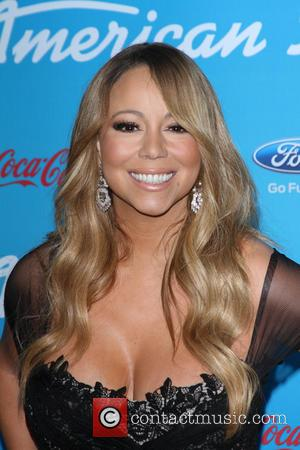Mariah Carey Teases Husband Nick Cannon With A Sexy Cleavage Close-up