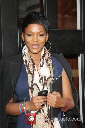 Caroline Chikezie - International Women's Day 2nd annual WIE Symposium at the Hospital Club- Arrivals - London, United Kingdom -...