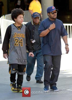 Ice Cube and Shareef Jackson - Celebrities arrive at the Staples Center to watch the Los Angeles Lakers vs. Chicago...