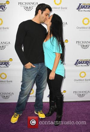 Gilles Marini and Carole Marini - Lakers casino night fundraiser benefiting the Lakers Youth Foundation at Club Nokia - Arrivals...