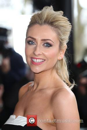 Gemma Merna - The Tric Awards 2014 held at the Grosvenor House Hotel - Arrivals - London, United Kingdom -...