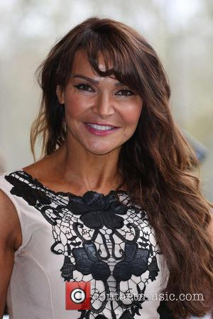 Lizzie Cundy - The Tric Awards 2014 held at the Grosvenor House Hotel - Arrivals - London, United Kingdom -...