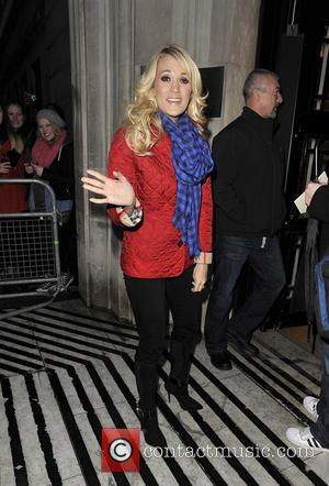 Carrie Underwood - Carrie Underwood arriving at the BBC Radio 2 studios - London, United Kingdom - Wednesday 13th March...