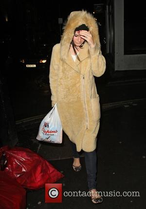 Lana Del Rey - Lana Del Rey walking back through Soho to her hotel after shopping for crisps and diet...