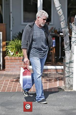 Ron Perlman - Ron Perlman is seen at Fred Segal enjoying lunch with a friend. - Los Angeles, CA, United...
