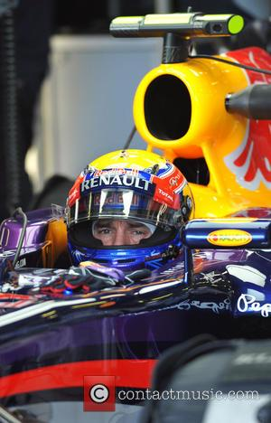 Mark Webber sits in his Red Bull F1 car waiting to go out on track in practice for the Australian...