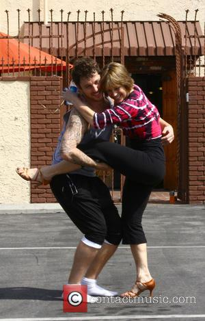 Dorothy Hamill and Tristan MacManus - Dorothy Hamill and partner Tristan MacManus practice some dance moves outside the 'Dancing with...