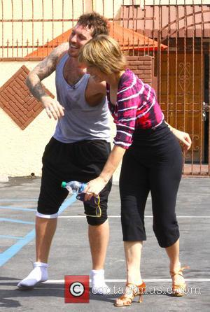 Tristan MacManus and Dorothy Hamill - Dorothy Hamill and Tristan MacManus horse around outside the rehearsal studio for 'Dancing with...