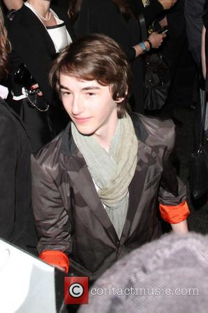 Isaac Hempstead-Wright - Premiere of the third season of HBO Series 'Game of Thrones' - Outside - Los Angeles, California,...