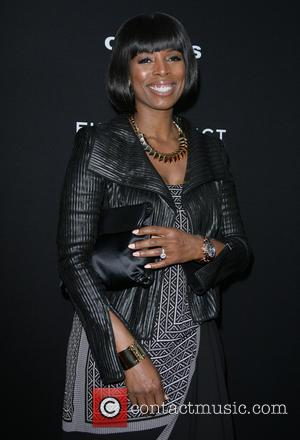Tasha Smith - Los Angeles Premiere of 'Olympus Has Fallen' held at ArcLight Hollywood Theatre - Los Angeles, California, United...