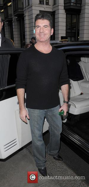 Simon Cowell - Celebrities At The Dorchester Hotel