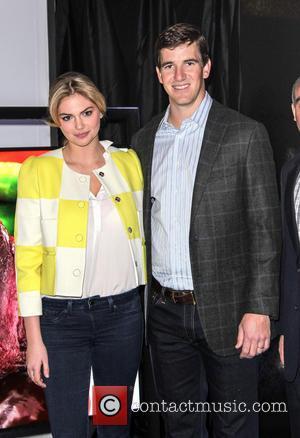 Kate Upton and Eli Manning