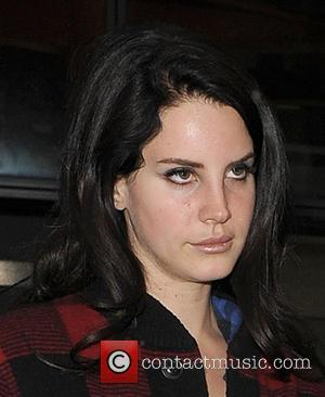 Lana Del Rey - A rather camera-shy Lana Del Rey arriving at Heathrow Airport on a flight from Berlin. Lana...
