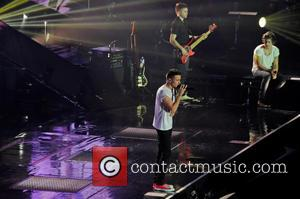 One Direction, Liam Payne and Harry Styles - One Direction performing in concert at the LG Arena - Birmingham, United...