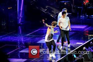 One Direction, Niall Horan, Liam Payne and Louis Tomlinson - One Direction performing in concert at the LG Arena -...