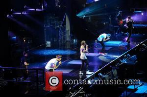 One Direction, Niall Horan, Zayn Malik, Liam Payne, Harry Styles and Louis Tomlinson - One Direction performing in concert at...