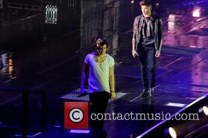 One Direction, Zayn Malik and Harry Styles - One Direction performing in concert at the LG Arena - Birmingham, United...