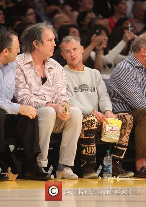 Flea of The Red Hot Chilli Peppers - Celebrities watch the LA Lakers vs. The Washington Wizards at the Staples...