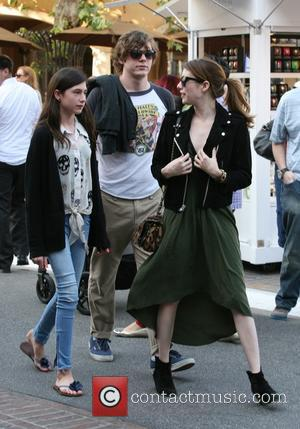 Emma Roberts, Evan Peters and Grace Nickels - Emma Roberts tries to go undetected with boyfriend Evan Peters and her...