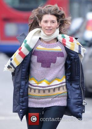 Jools Oliver - Jools Oliver returns to her Range Rover after dropping her children off at school. Jools can be...