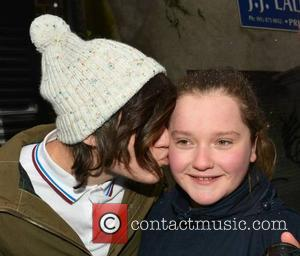 Frankie Cocozza - Frankie Cocozza greets his fans in a snow shower at the stage door of The Academy ahead...