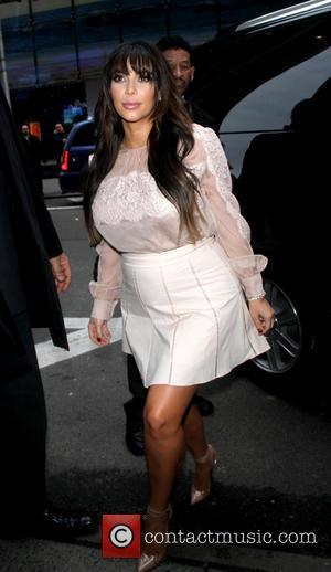 Kim Kardashian Distances Herself From Fake Tweet